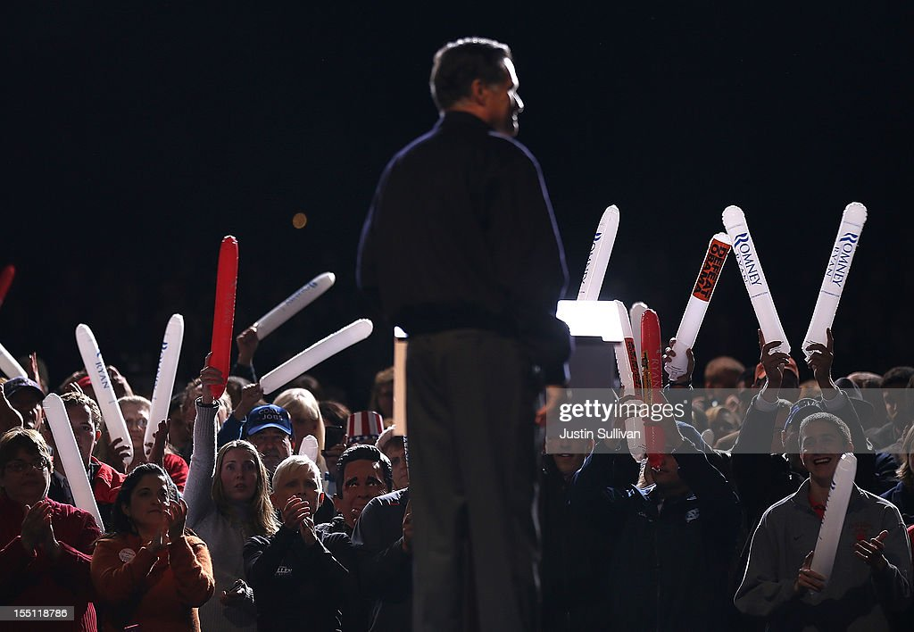 Supporters hold thunder sticks as Republican presidential candidate, former Massachusetts Gov. Mitt Romney speaks during a campaign event at Farm Bureau Live on November 1, 2012 in Virginia Beach, Virginia. With less than one week to go until election day, Mitt Romney is campaigning in Virginia.