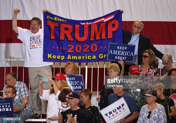 Supporters hold up a banner as US President Donald Trump speaks during a campaign rally at the Las Vegas Convention Center on September 20 2018 in...
