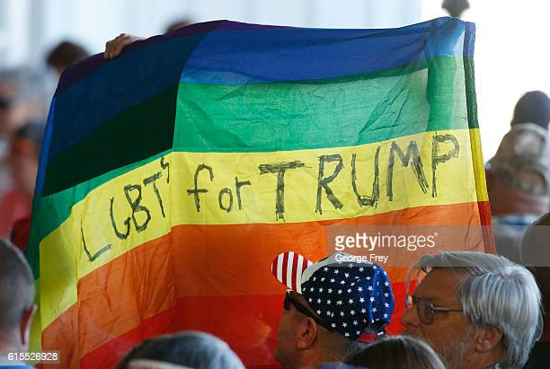 Supporters hold up a gay pride flag for Republican presidential candidate Donald Trump on October 18 2016 in Grand Junction Colorado Trump is on his...