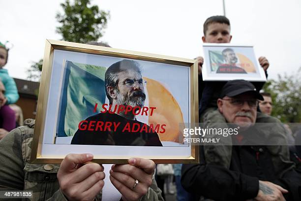 Supporters hold up pictures of detained Sinn Fein leader Gerry Adams calling for his release during a rally in Belfast, Northern Ireland on May 3,...