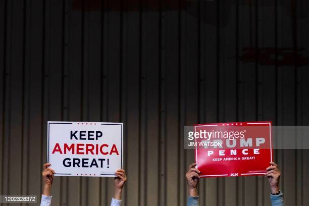 Supporters hold up placards as the US president delivers remarks at a Keep America Great rally in Las Vegas, Nevada, on February 21, 2020.