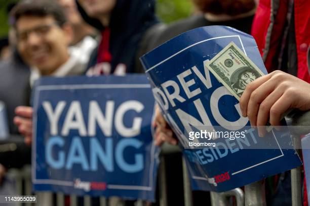 Supporters hold up placards during a campaign rally for Andrew Yang founder of Venture for America and 2020 Democratic presidential candidate not...