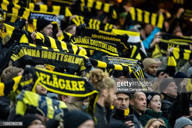 AIK supporters hold up scarves before an Allsvenskan match between AIK and Malmo FF at Friends Arena on October 29 2018 in Stockholm Sweden