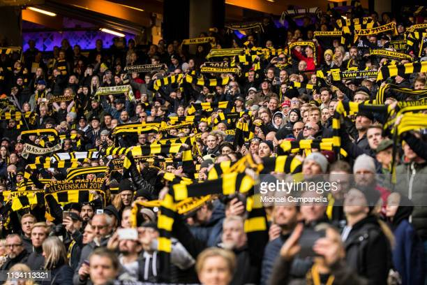 AIK supporters hold up scarves during an Allsvenskan match between AIK and Ostersunds FK at Friends Arena on March 31 2019 in Stockholm Sweden
