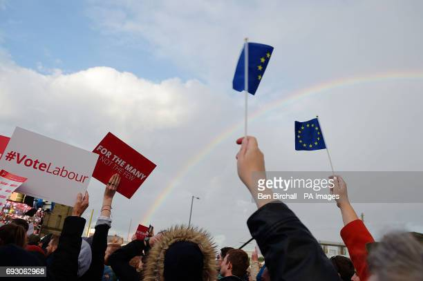 Supporters hold up signs and EU flags while Labour leader Jeremy Corbyn speaks at a rally in Birmingham while on the General Election campaign trail