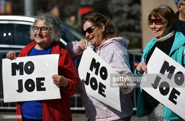 Supporters hold up signs before Democratic presidential candidate Joe Biden holds a rally at Kiener Plaza Park in St. Louis, Missouri on March 7,...