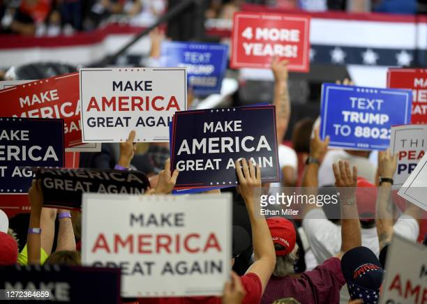 Supporters hold up signs during a campaign event for U.S. President Donald Trump at Xtreme Manufacturing on September 13, 2020 in Henderson, Nevada....