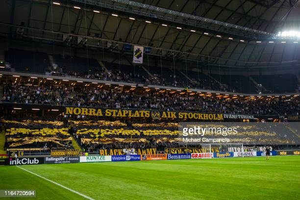 Supporters hold up signs during a UEFA Europa League qualification match between AIK and Celtic FC at Friends arena on August 29, 2019 in Solna,...