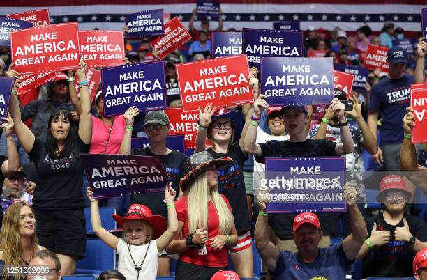 Supporters hold up signs durng a campaign rally for U.S. President Donald Trump at the BOK Center, June 20, 2020 in Tulsa, Oklahoma. Trump is holding...
