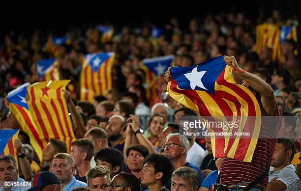 Supporters hold up the Catalan flag during the UEFA Champions League Group C match between FC Barcelona and Celtic FC at Camp Nou on September 13...