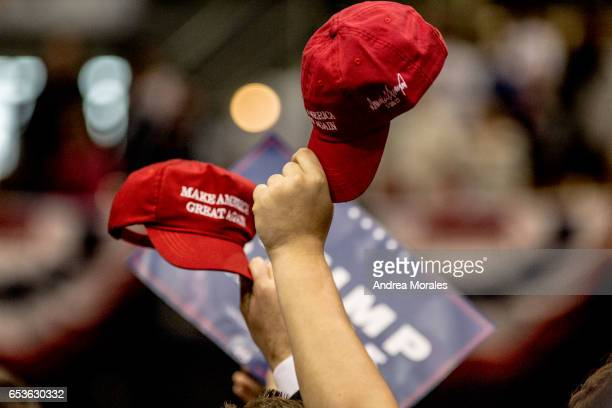 Supporters hold up their hats during a rally held by President Trump on March 15 2017 in Nashville Tennessee During his speech President Trump...