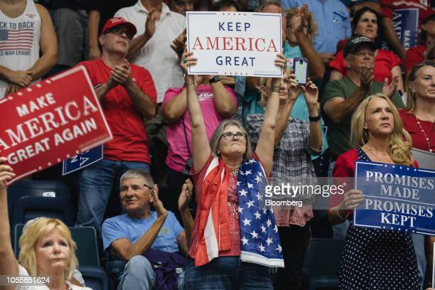 Supporters holds placards as US President Donald Trump not pictured speaks during a campaign rally in Estero Florida US on Wednesday Oct 31 2018...