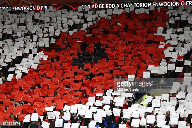 Supporters holds up placards to form a giant poppy ahead of Remembrance Sunday prior to the FIFA 2018 World Cup Qualifier between Wales and Serbia at...