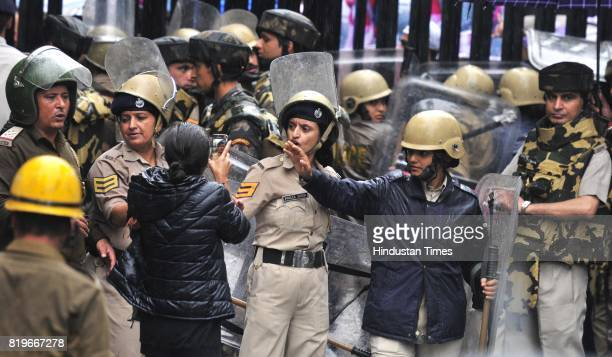 BJP supporters in a heated argument with police officials during the protest against rape and murder of Kotkhai girl at Mall road on July 20 2017 in...