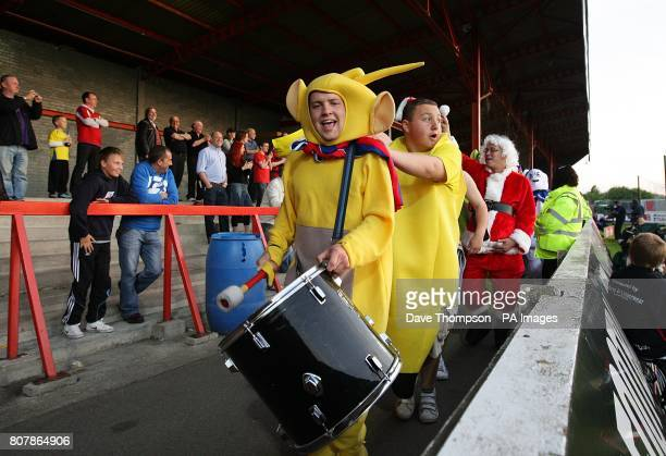 Supporters in fancy dress do a conga around the stadium