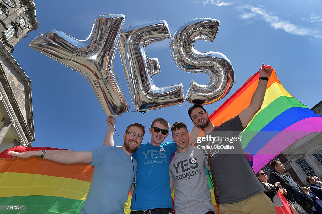 Supporters in favour of same-sex marriage pose for a photograph as thousands gather in Dublin Castle square awaiting the referendum vote outcome on May 23, 2015 in Dublin, Ireland. Voters in the Republic of Ireland are taking part in a referendum on legalising same-sex marriage on Friday. The referendum was held 22 years after Ireland decriminalised homosexuality with more than 3.2m people being asked whether they want to amend the country's constitution to allow gay and lesbian couples to marry.