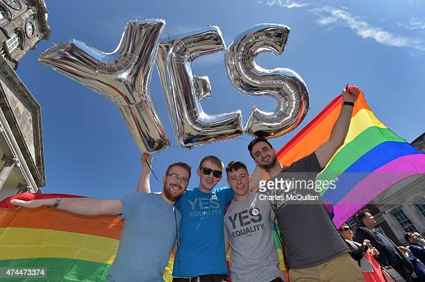 Supporters in favour of samesex marriage pose for a photograph as thousands gather in Dublin Castle square awaiting the referendum vote outcome on...