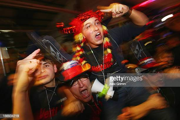 Supporters in his home town celebrate the third World Championship title of German Formula One driver Sebastian Vettel during a public viewing in...
