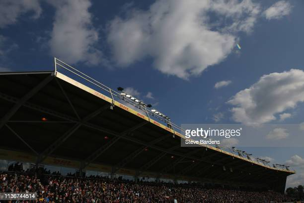 Supporters in the DHL stand watch the action during the Gallagher Premiership Rugby match between Harlequins and Northampton Saints at Twickenham...