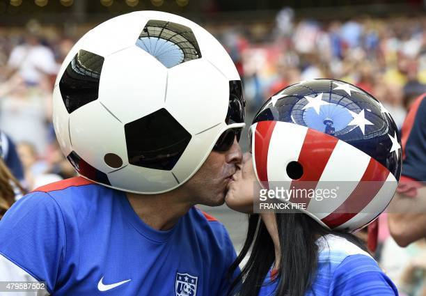Supporters kiss ahead the final football match between USA and Japan during their 2015 FIFA Women's World Cup at the BC Place Stadium in Vancouver on...