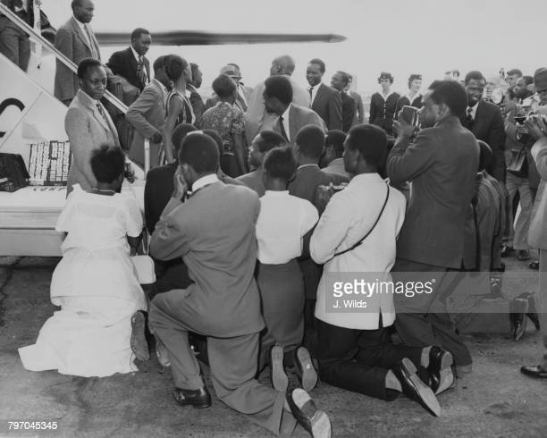 Supporters kneel in greeting to Mutesa II Kabaka of Buganda on his arrival at London Airport 11th September 1961 Mutesa is in Britain for talks with...