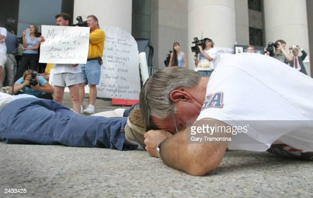 Supporters lay in front of the State Judicial building in protest of the removal if a Ten Commandments monument August 27 2003 in Montgomery Alabama...