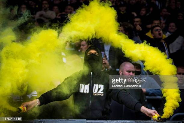 Supporters light flares during an Allsvenskan match between Hammarby IF and AIK at Tele2 Arena on September 22, 2019 in Stockholm, Sweden.