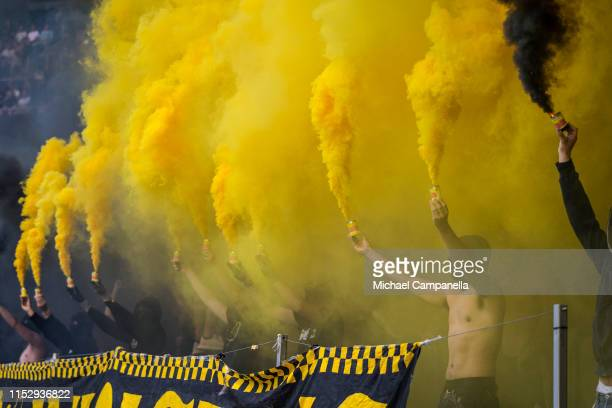 Supporters light smoke boms during an Allsvenskan match between AIK and Malmö FF at Friends Arena on June 30, 2019 in Stockholm, Sweden.