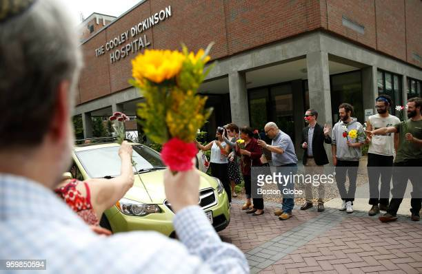 Supporters line the driveway at the Cooley Dickinson Hospital in Northampton MA as a car carrying Lucio Perez leaves the hospital on May 17 2018...