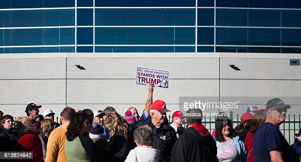 Supporters line up for a campaign rally with Republican presidential nominee Donald Trump at Mohegan Sun Arena on October 10 2016 in WilkesBarre...
