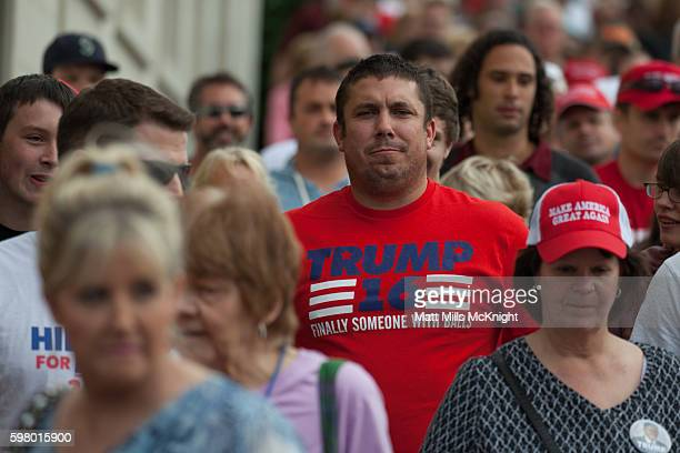 Supporters line up outside a campaign rally for Republican presidential candidate Donald Trump at Xfinity Arena on August 30 2016 in Everett...