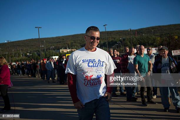 Supporters line up outside for a campaign rally for Republican presidential nominee Donald Trump on October 10 2016 in WilkesBarre Pennsylvania Trump...