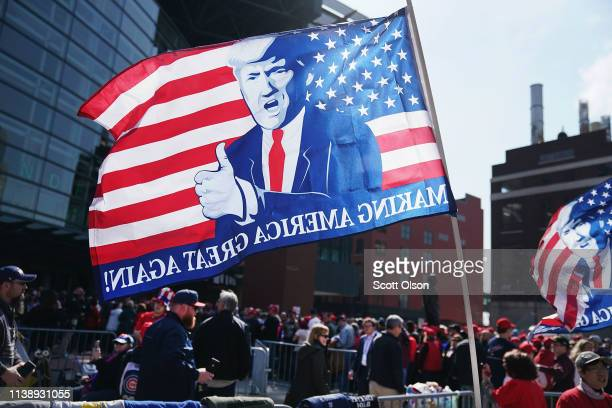 Supporters line up outside of the Van Andel Arena before the start of a rally with President Donald Trump on March 28 2019 in Grand Rapids Michigan...