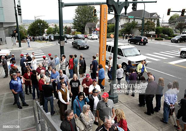 Supporters line up past the Snohomish County Campus to see Republican presidential nominee Donald Trump speak at a rally at Xfinity Arena in Everett...