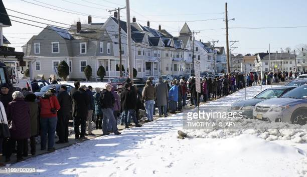 Supporters line up to get in the gym to listens to Democratic presidential candidate and former South Bend Indiana mayor Pete Buttigieg as he holds a...