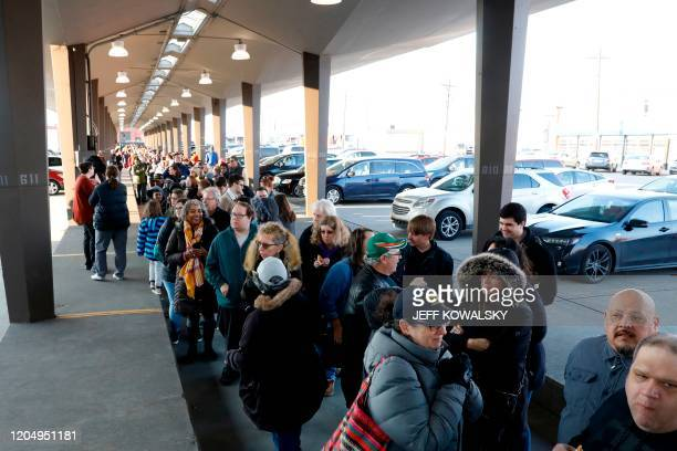 Supporters line up to hear Democratic White House hopeful Massachusetts Senator Elizabeth Warren speak to supporters during a campaign rally at...