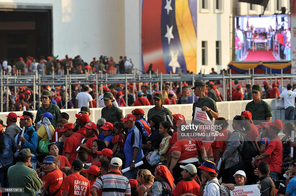 Supporters line up to pay their last respects to late Venezuelan President Hugo Chavez, outside the Military Academy in Caracas on March 8, 2013. Venezuela gave Hugo Chavez a lavish farewell on Friday at a state funeral that brought some of the world's most notorious strongmen to tears, with music, prayers and a fiery speech by his successor. AFP PHOTO/Guillermo Legaria