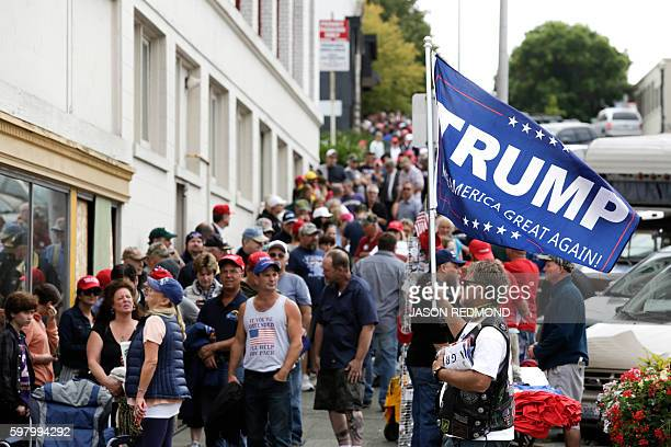 Supporters line up to see Republican presidential nominee Donald Trump speak at a rally at Xfinity Arena in Everett Washington on August 30 2016 /...