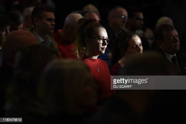 Supporters listen as Britain's main opposition Labour Party leader Jeremy Corbyn and Britain's main opposition Labour Party shadow Chancellor of the...
