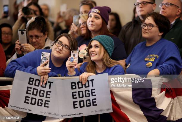 Supporters listen as Democratic presidential candidate former South Bend Indiana Mayor Pete Buttigieg speaks at a town hall campaign event The...