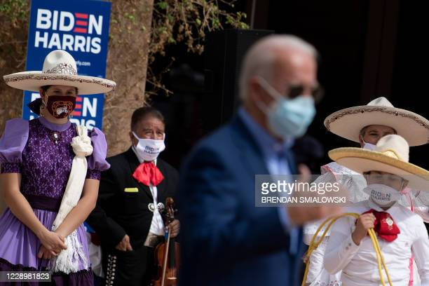Supporters listen as Democratic presidential candidate Joe Biden speak at the East Las Vegas Community Center about the effects of Covid-19 on...