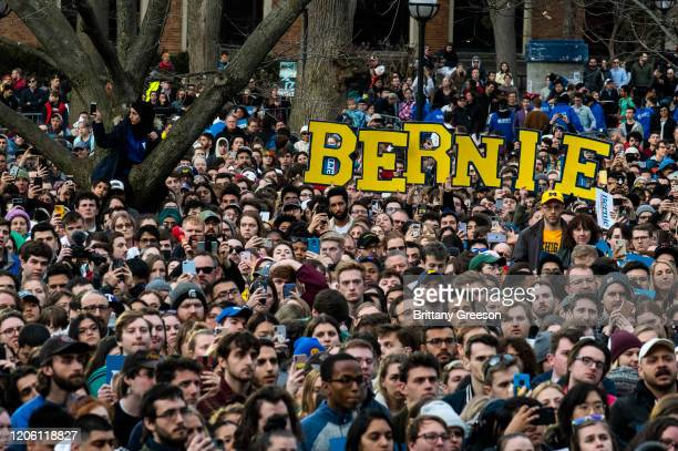 Supporters listen as Democratic presidential candidate Sen Bernie Sanders speaks during a campaign rally on March 8 2020 in Ann Arbor Michigan...