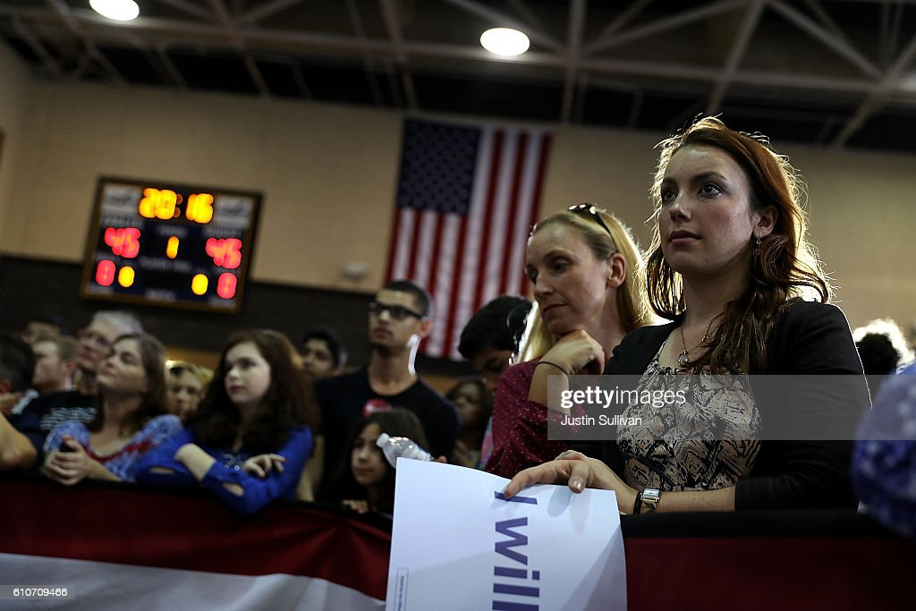 Supporters listen as Democratic presidential nominee former Secretary of State Hillary Clinton speaks during a campaign rally at Wake Technical Community College on September 27, 2016 in Raleigh, North Carolina. Hillary Clinton is campaigning in North Carolina a day after facing off with republican presidential nominee Donald Trump in the first presidential debate.