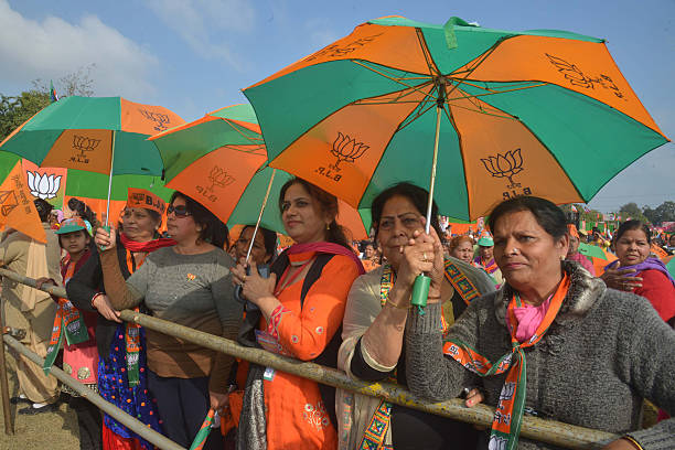 Supporters listen as Indian Prime Minister Narendra Modi speaks during the Bharatiya Janata Party rally at the PAP ground in Jalandhar on January 27..