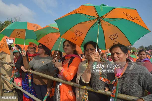 Supporters listen as Indian Prime Minister Narendra Modi speaks during the Bharatiya Janata Party rally at the PAP ground in Jalandhar on January 27...