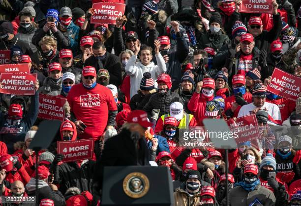 Supporters listen as President Donald Trump speaks at a campaign rally on November 01, 2020 in Washington, Michigan. Only days before the U.S....