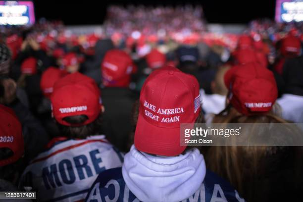 Supporters listen as President Donald Trump speaks during a campaign rally at the Kenosha Regional Airport on November 02, 2020 in Kenosha,...