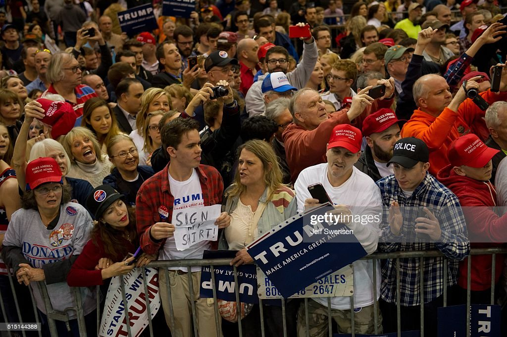 Supporters listen as Republican presidential candidate Donald Trump speaks at a campaign event at the I-X Center March 12, 2016 in Cleveland, Ohio.