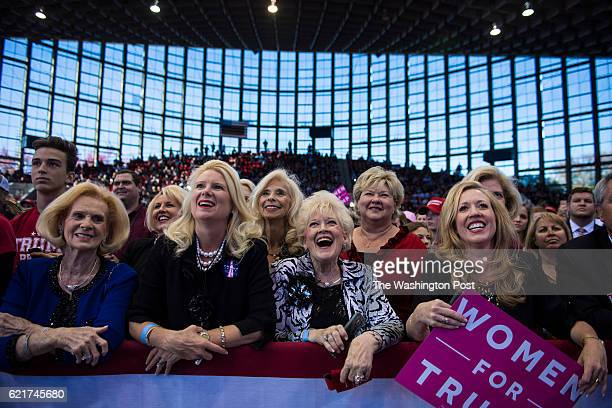 Supporters listen as Republican presidential candidate Donald Trump speaks during a campaign event at JS Dorton Arena in Raleigh NC on Monday...