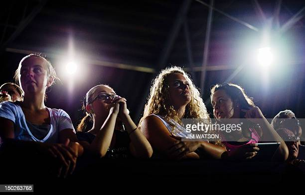 Supporters listen as US President Barack Obama delivers remarks during a campaign event at Herman Park in Boone Iowa on August 13 2012 AFP PHOTO/Jim...